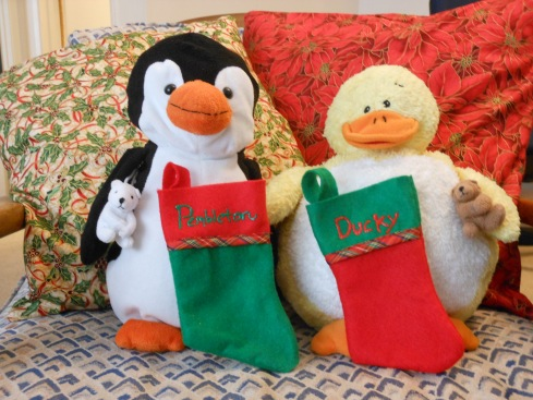 Baby animals with their stockings.